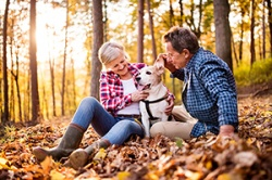 Retired Couple In the Woods with their dog