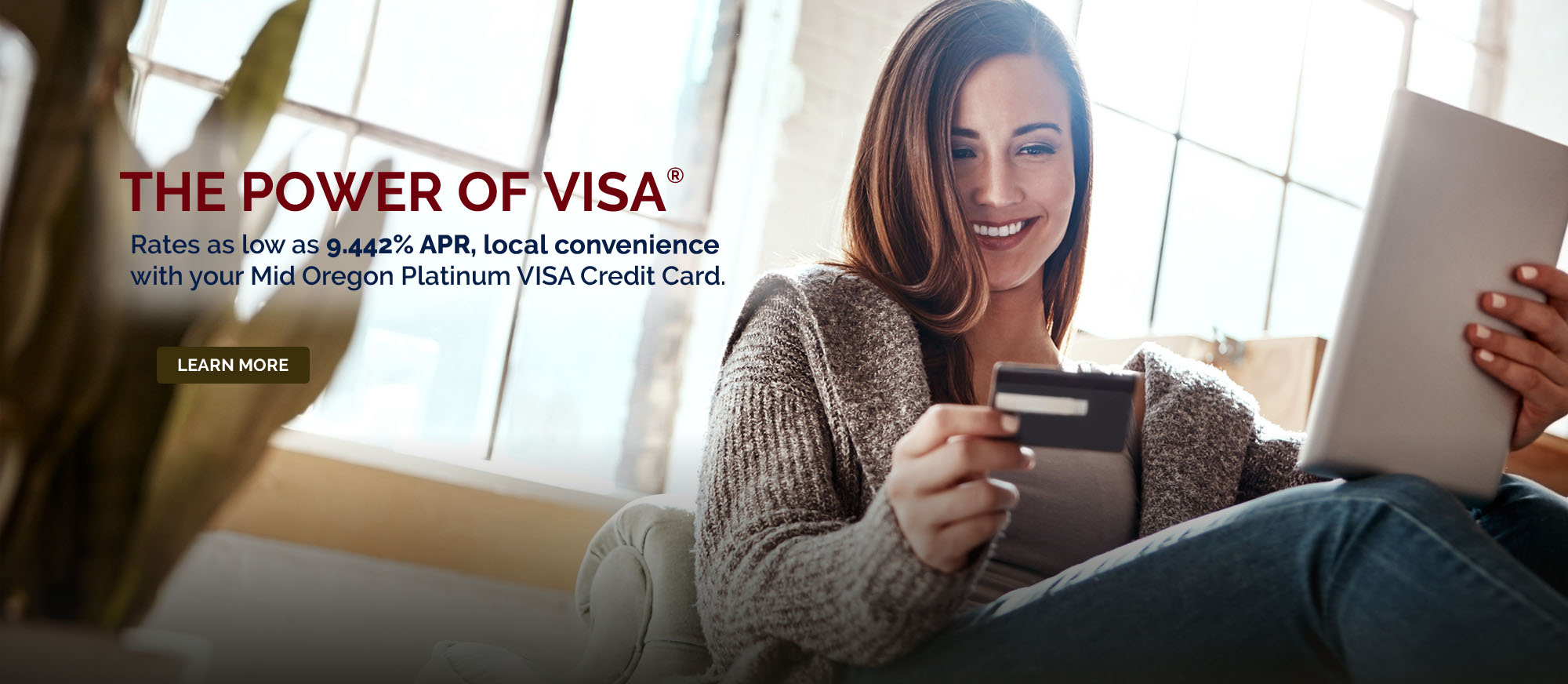 Woman relaxing and shopping online holding VISA Credit Card