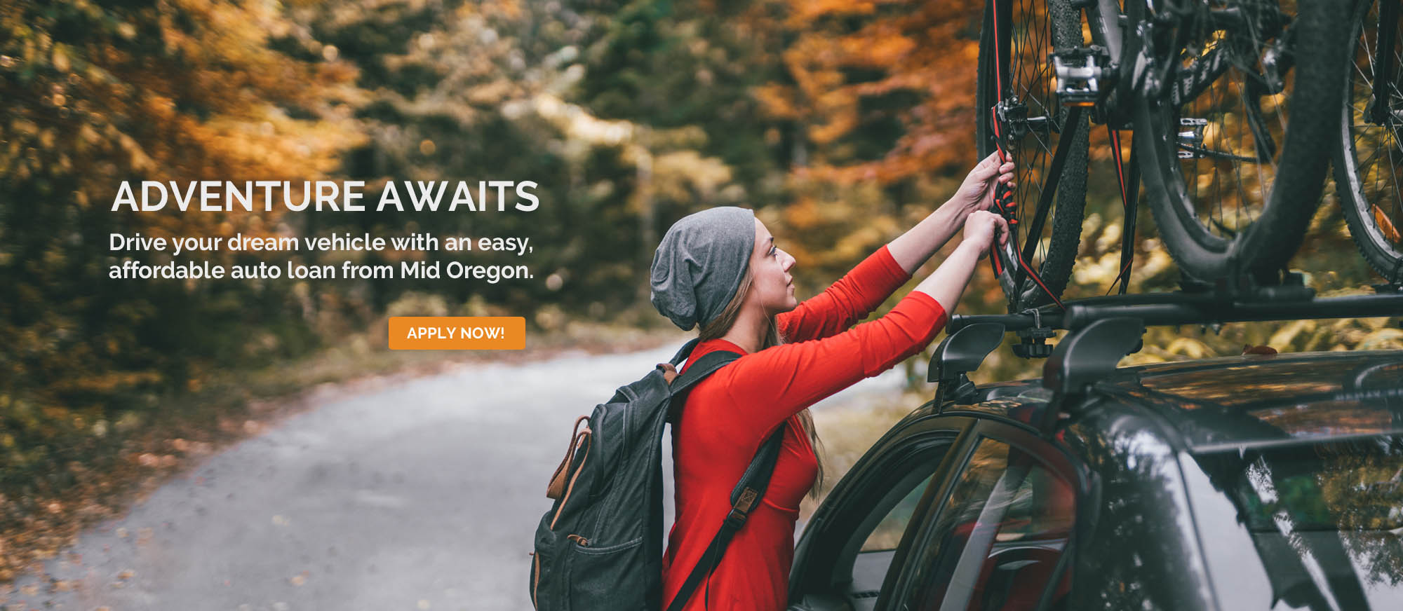 Auto loans, Woman with bike on roof of vehicle outdoors